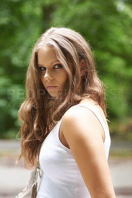 Buy stock photo Portrait of a beautiful young woman standing in a forest
