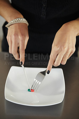 Buy stock photo Shot of a young woman suffering from anorexia