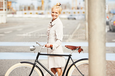 Buy stock photo A beautiful blonde woman crossing the street  with her vintage bicycle