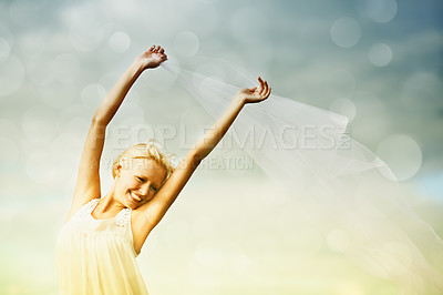 Buy stock photo A young woman holding chiffon blowing in the wind surrounded by bokeh