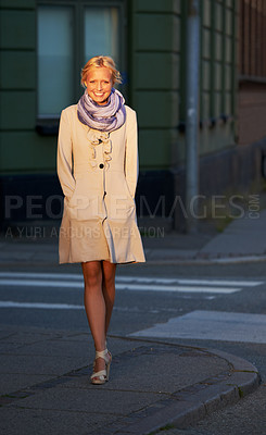 Buy stock photo A beautiful young woman walking in the street at sunset