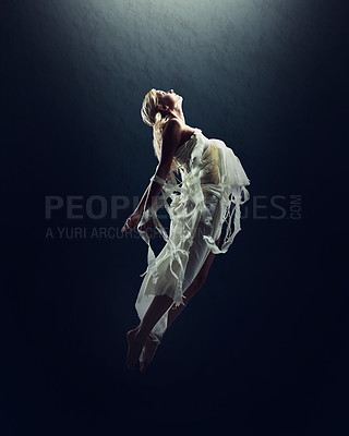 Buy stock photo A beautiful young woman floating in the air isolated against black