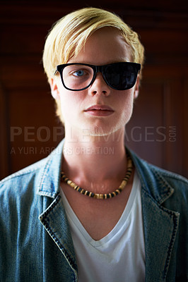 Buy stock photo Attractive young guy wearing hipster glasses with one side blacked out
