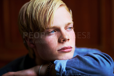 Buy stock photo Thoughtful and handsome young blonde guy with very blue eyes
