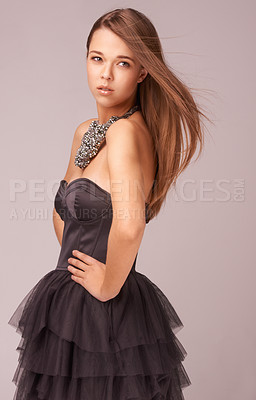 Buy stock photo Stylish young woman in a cocktail dress against a pink background