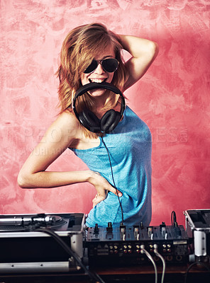 Buy stock photo Fun portrait of a dj with her earphones in her mouth