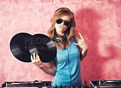 Buy stock photo A young female dj gesturing and holding records
