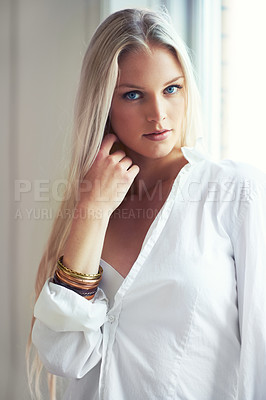 Buy stock photo Portrait of an attractive woman wearing a shirt and standing in her bedroom