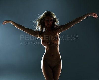 Buy stock photo Silhouette of a curvaceous nude woman against a dark background
