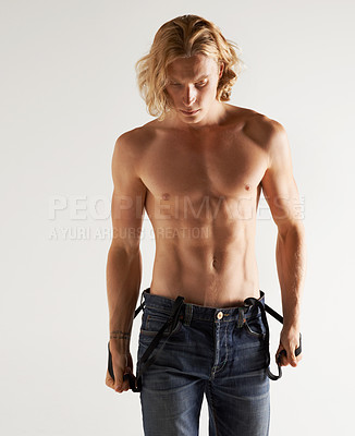 Buy stock photo Studio shot of a handsome young shirtless man