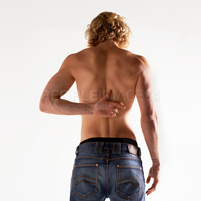 Buy stock photo Rear view of a young shirtless man gesturing behind his back