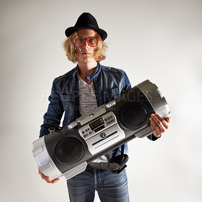 Buy stock photo Portrait of a handsome young man holding a boombox