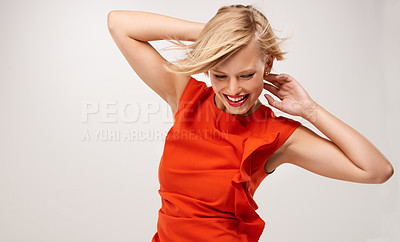 Buy stock photo An attractive young woman wearing a red dress
