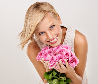 Buy stock photo Portrait of an attractive young woman holding a bouquet of flowers