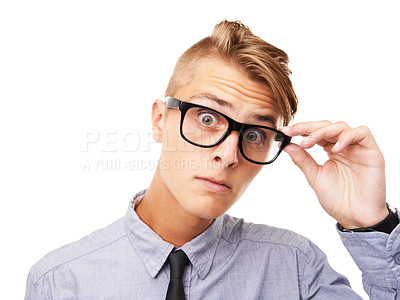 Buy stock photo Studio portrait of an expressive young man wearing glasses isolated on white