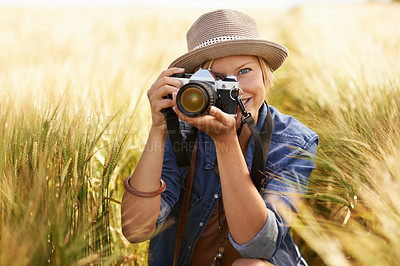 Buy stock photo Portrait of an attractive young woman taking a photograph