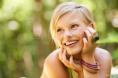 Buy stock photo An attractive young woman laughing outside in nature