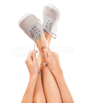 Buy stock photo Closeup of a woman's legs while she's tying her shoelaces