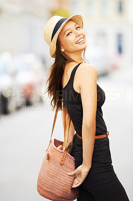 Buy stock photo A stunning young woman walking down the street