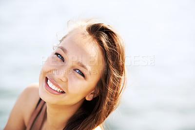 Buy stock photo A stunning young woman smiling outside