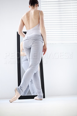 Buy stock photo Rear view of a ballerina in position before a mirror