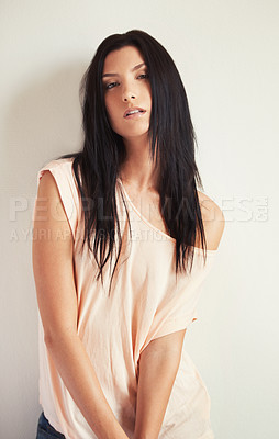 Buy stock photo Portrait of a beautiful brunette staring seductively at the camera