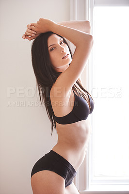 Buy stock photo Portrait of a sexy young brunette woman standing in her lingerie