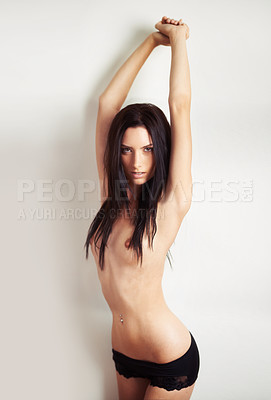 Buy stock photo Portrait of a beautiful young topless woman with her arms raised
