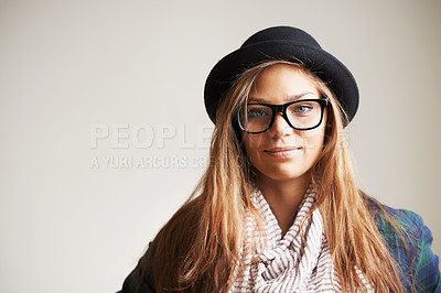 Buy stock photo A young woman smiling at the camera against a white background