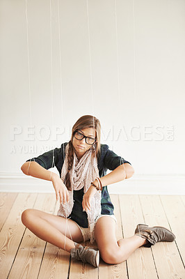 Buy stock photo A conceptual image of a pretty hipster being held by strings like a puppet