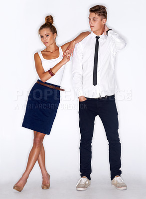 Buy stock photo A trendy young woman leaning on a young man's shoulder - white background
