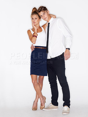 Buy stock photo Portrait of a trendy young man with his arm around a pretty girl on a white background