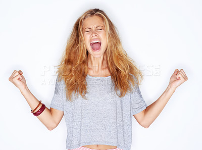 Buy stock photo A pretty young girl yelling out in frustration with her fists raised - white background