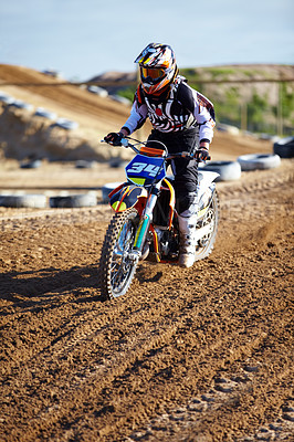 Buy stock photo A motocross rider on the track