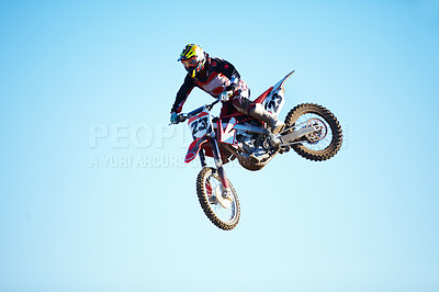 Buy stock photo A motocross rider in mid-air
