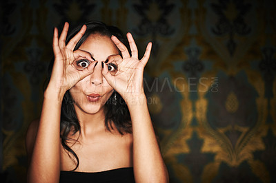 Buy stock photo A young girl gesturing and having an awesome time while out partying