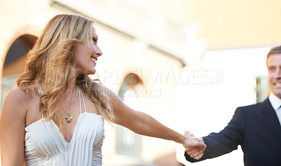 Buy stock photo A beautiful woman walks hand in hand with her boyfriend
