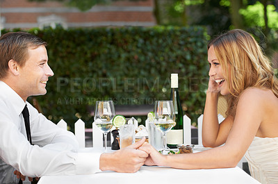 Buy stock photo A couple enjoy each other's company in a restaurant