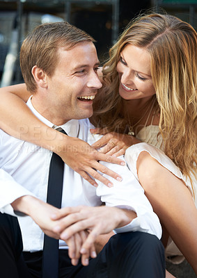Buy stock photo A beautiful woman embraces her handsome boyfriend
