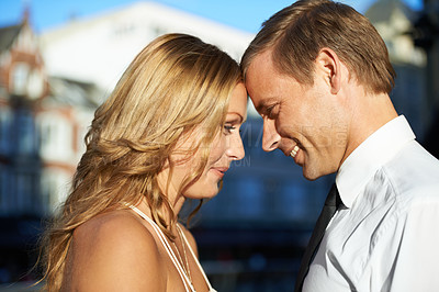Buy stock photo A beautiful couple with their foreheads rested against each other
