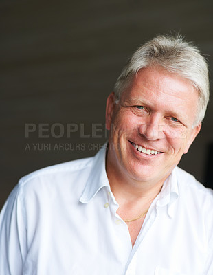 Buy stock photo Cropped portrait of a senior man against a dark background