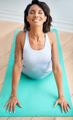 Buy stock photo A fit young woman doing stretches on her pilates mat