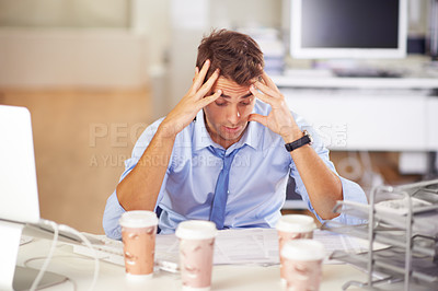 Buy stock photo Overwhelmed businessman at his desk after many cups of coffee