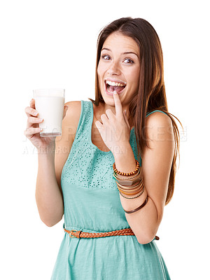 Buy stock photo Studio portrait of an attractive young woman with a milk moustache against a white background