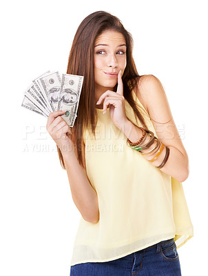 Buy stock photo Studio shot of an attractive young woman  holding up fanned out banknote isolated on white