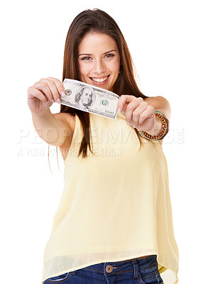 Buy stock photo Studio shot of an attractive young woman  holding up a banknote isolated on white