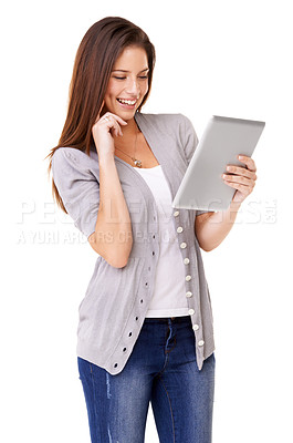 Buy stock photo Studio shot of a young woman using a digital tablet isolated on white