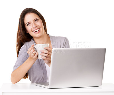 Buy stock photo Studio shot of a happy young woman enjoying a beverage while using a laptop against a white background