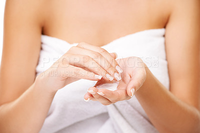 Buy stock photo Cropped shot of a young woman holding body lotion in her hands