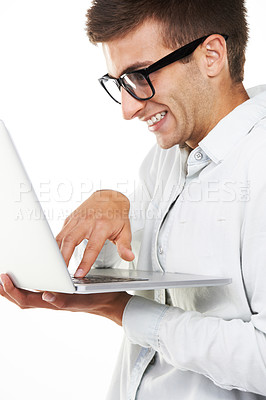Buy stock photo A nerdy hipster touching the keys on his laptop and smiling